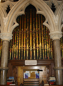 The organ console and central pipe arch