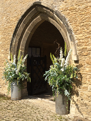 Wedding flowers decorating the church porch